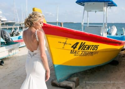 beautiful bride in front of boat